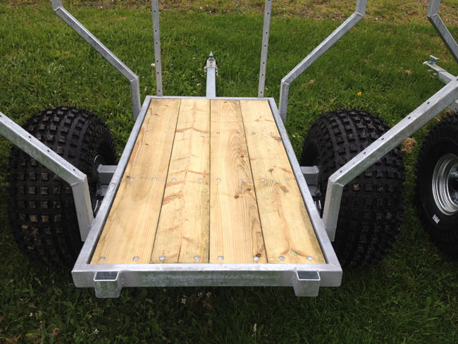 Bed planked in model of ATV woods trailer